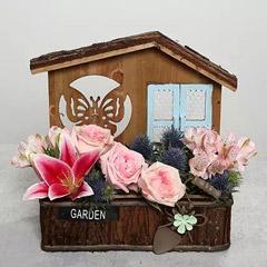 Beautiful Flower Arrangement in Hut Shaped Wooden Base