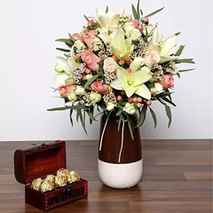 Beautiful White and Peach Flowers In Vase With Rocher