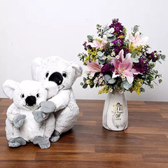 Pink and Purple Flowers In Vase With Teddy Bears