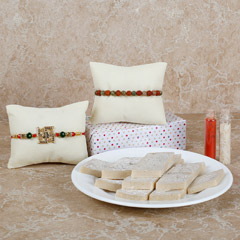 Set Of 2 Rakhis And Sweets
